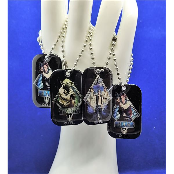3)  LOT OF 4 STAR WARS DOG TAGS/KEY CHAINS