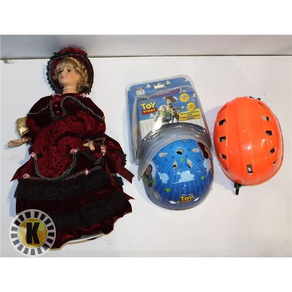 BOX OF DOLL  AND TOY STORY HELMET AND  KNEE PADS