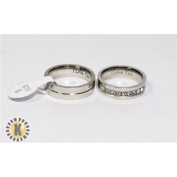 NEW STAINLESS STEEL RING SET. SAYS I LOVE YOU ON B