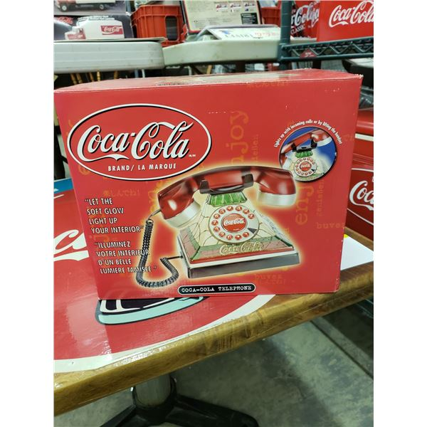 COCA COLA TELEPHONE . LIGHTS UP WITH CALL AND IS IN ORIGINAL PACKAGING