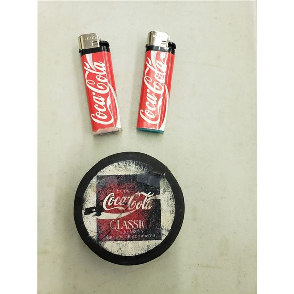 COCA COLA HOCKEY PUCK AND TWO LIGHTS, LIGHTER HAS FALEN OFF PUCK