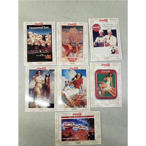 SEVEN COCA COLA CARDS FROM VARIOUS YEARS