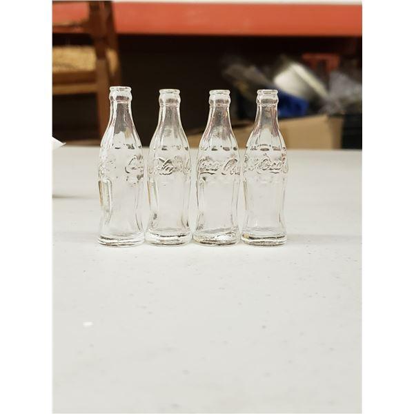 FOUR MINI GLASS COCA COLA BOTTLES