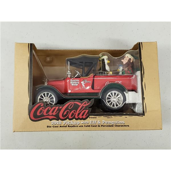 COCA COLA DIE CAST REPLICA OF1918 PICK UP WITH ELF AND PENGUINS