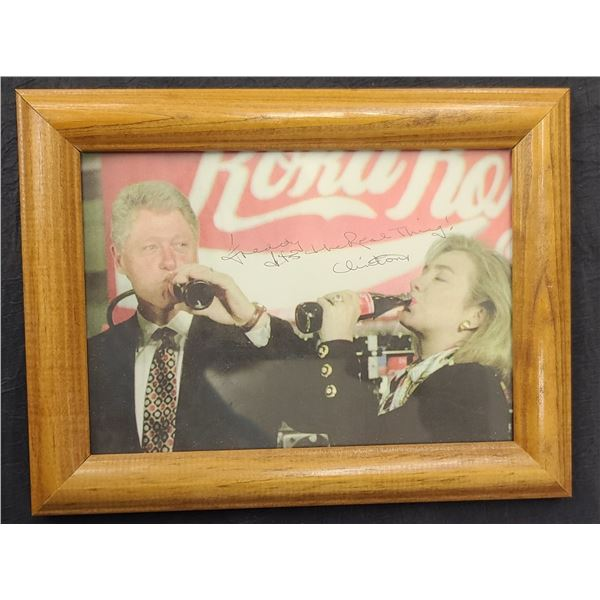 SIGNED IMAGE OF THE CLINTONS DRINKING COCA COLA, FRAMED