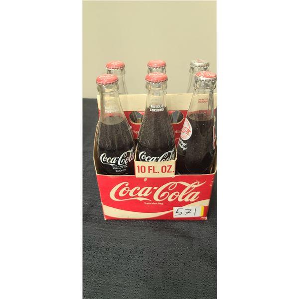 6 PACK FULLL OF COCA COLA