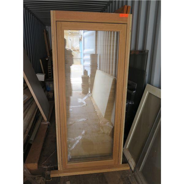 "Iroko casement window with louver shutter.  Approx. 31"" x 71"""