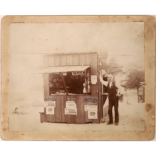 Mounted Photograph of Newspaper Shop Stand  [135730]