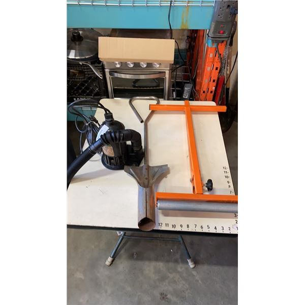 Sump pump, roller stand and vegetable planter
