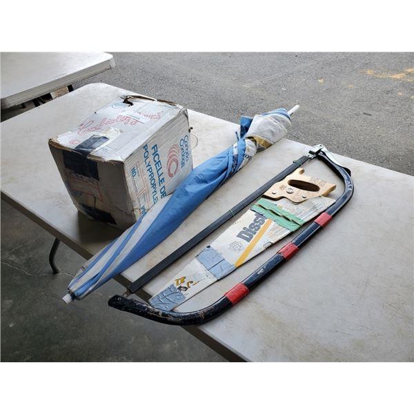 Box of 100% polypropylene twine with bow saw, handsaw and kokanee umbrella