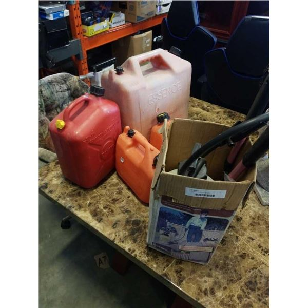 4 jerry cans and garden sprayer