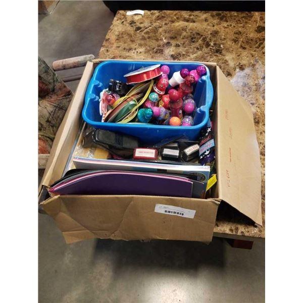 Box of bingo dabbers and office supplies