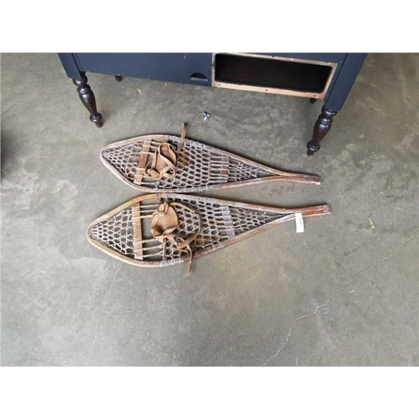 Pair of vintage wooden snow shoes