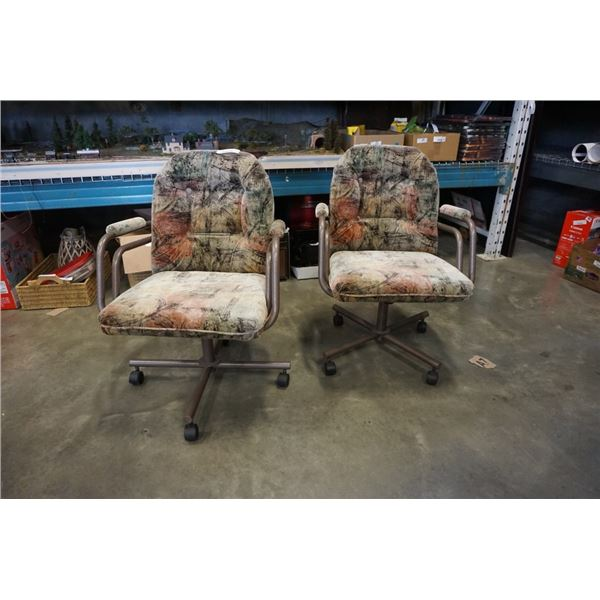 2 MCM castered arm chairs