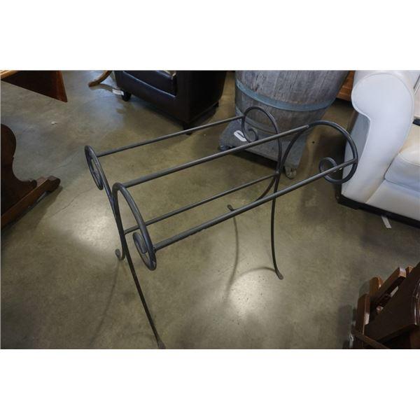 Solid metal blanket rack