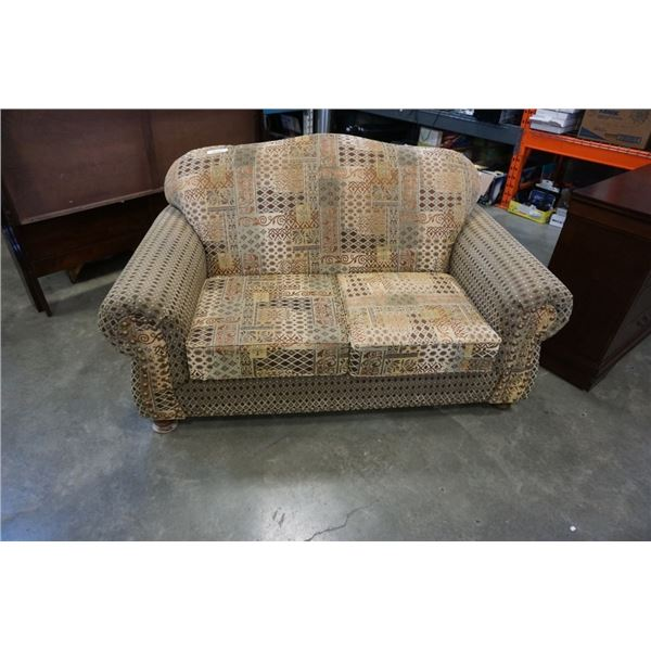 Rolled arm sofa with brass nail head