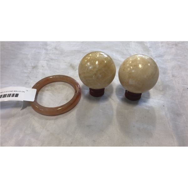 STONE BANGLE AND 2 STONE BALLS ON STANDS