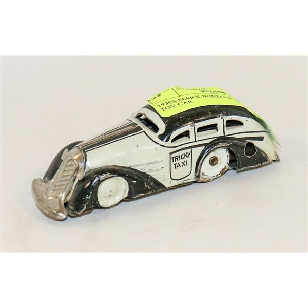 1930S MARX WIND UP TRICKY TAXI TOY CAR