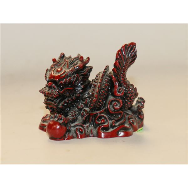 SMALL RES CARVED DRAGON STATUE