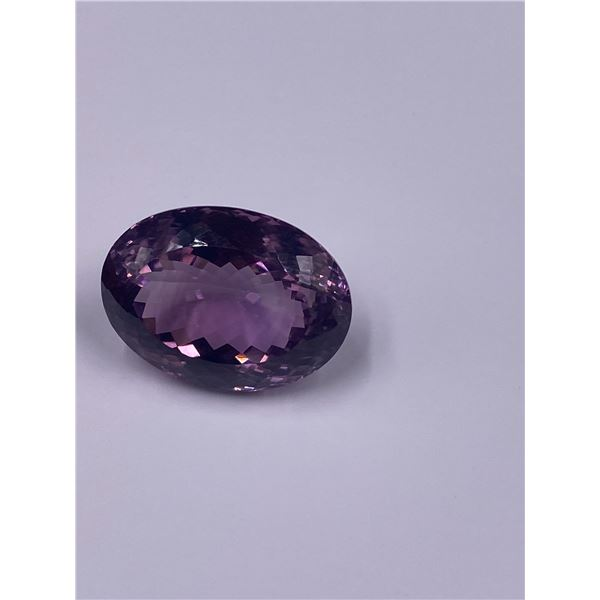 COLOSSAL AMETHYST MASTER CUT 59.75CT, 29.29 X 21.54 X 15.39MM, OVAL CUT, LOUPE CLEAN CLARITY,