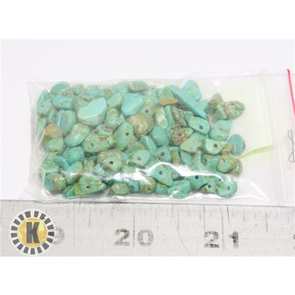 7)  LOT OF 28 CGRAMS OF DRILLED HOWELITE FOR