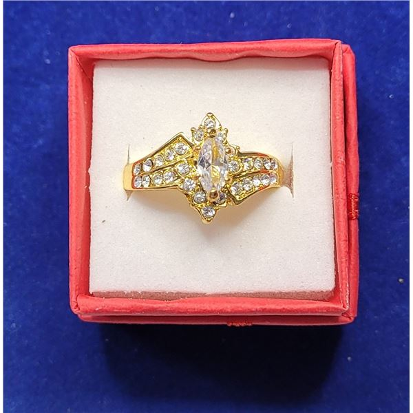 13)  GOLD TONE AND CLEAR CZ RING,  SIZE 9.