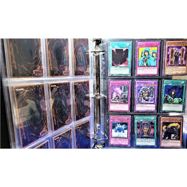 20)  BINDER CONTAINING 63 YO-GI-UH GAME CARDS