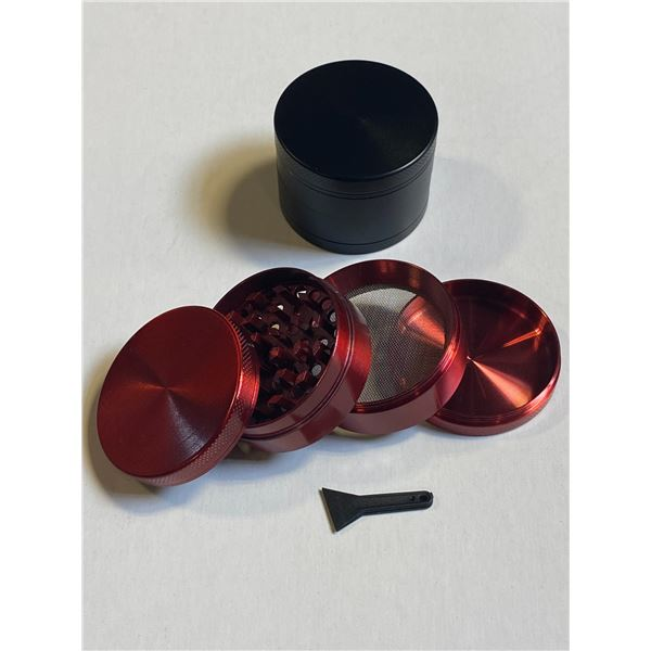LOT OF TWO HERB GRINDERS - BLACK / RED