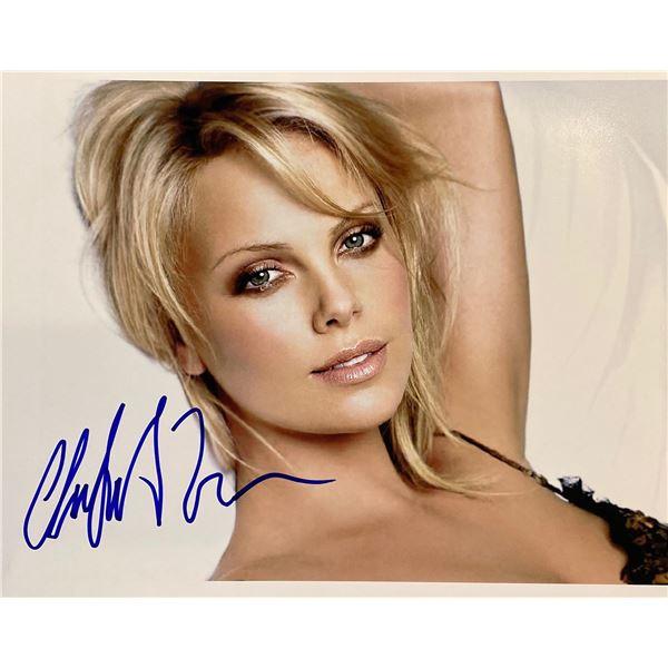 Charlize Theron signed photo