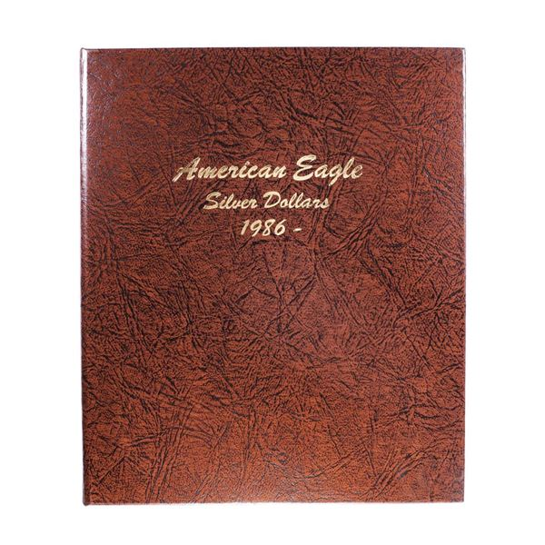 Lot of 1986-2016 $1 American Silver Eagle Coins in Book