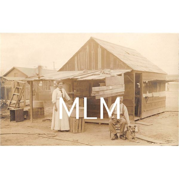 Man, Woman & Dog in front of shack Imperial, California Photo Postcard
