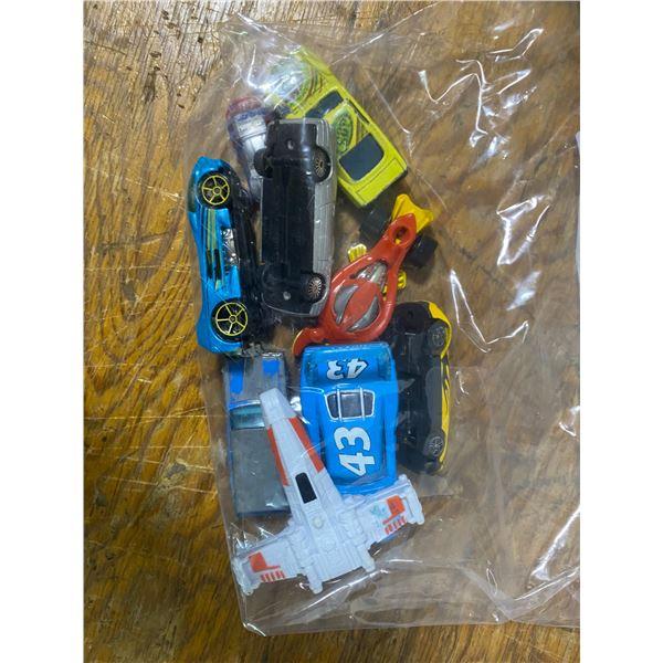 12 toy cars; Hot Wheels Mattel, plastic