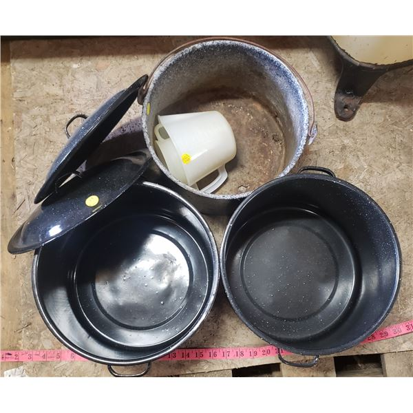 two large pots good for canning older decorator pot with some holes measuring cups