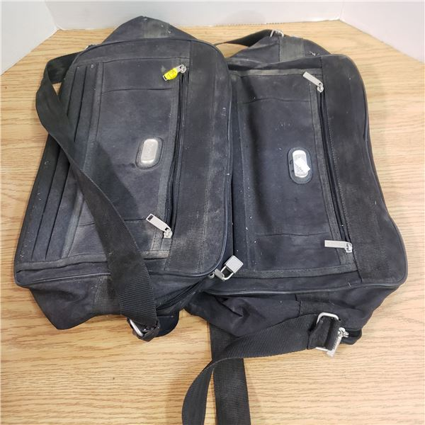 2 black carry on bags