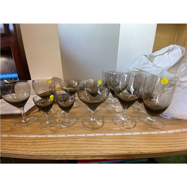 15 Smoky grey crystal glasses with clear stems 4 goblets, 3 Ice Beverage glasses, 3 sherry glasses,