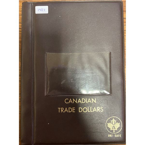 Canadian Trade Dollar stock book. Made by Uni-Safe. Houses 36 coins or tokens.