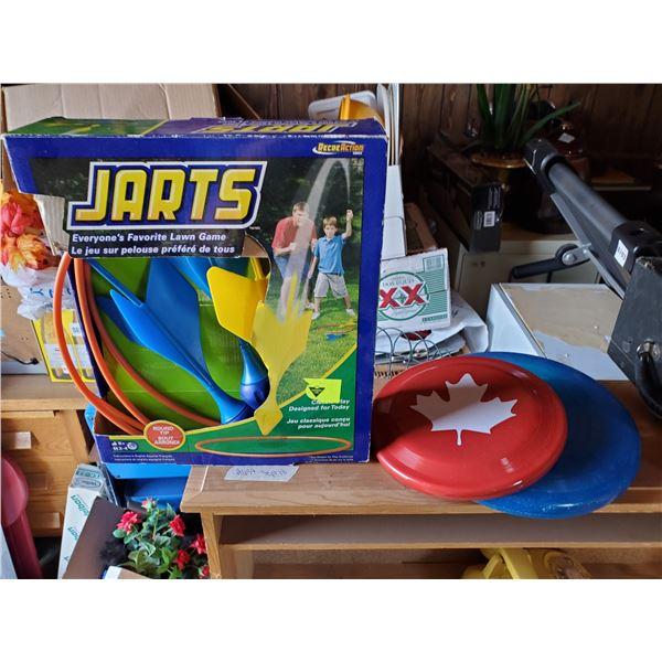 Jarts & 2 frisbees
