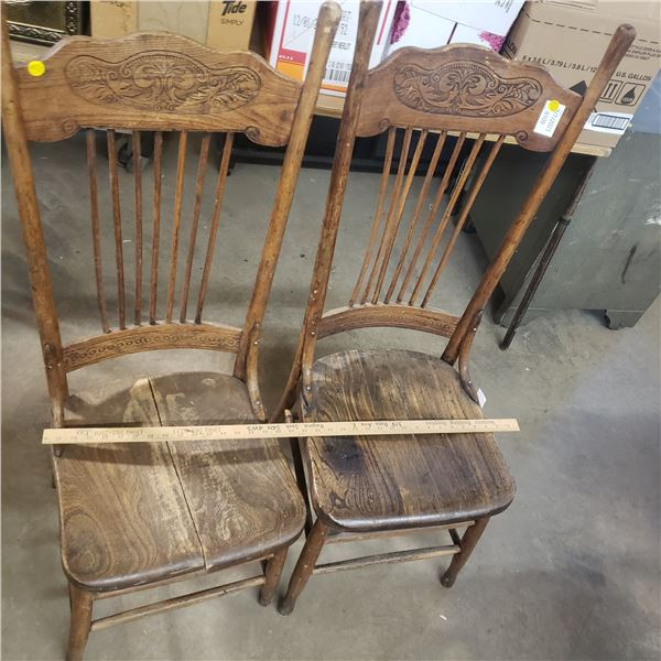 Two antique chairs (one is split ) old hard wood chairs
