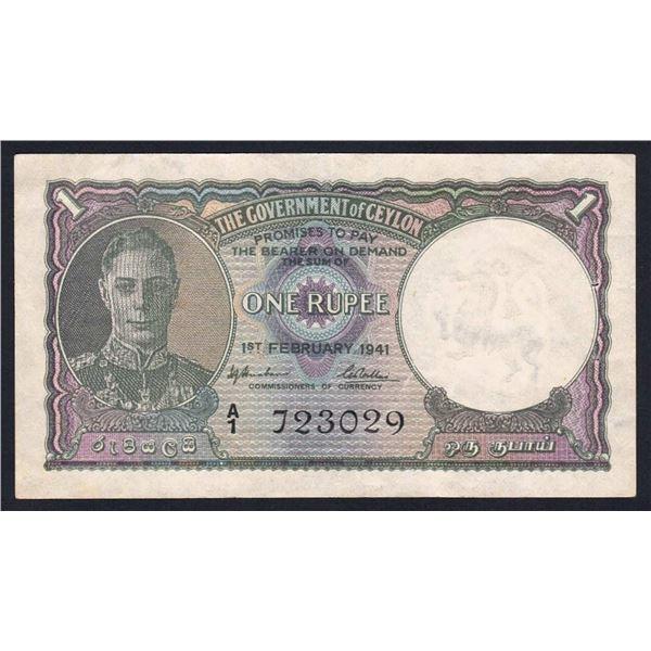 "CEYLON 1 Rupee. 1.2.1941. George VI Portrait. 1ST PREFIX ""A/1"". Straight edge at left"