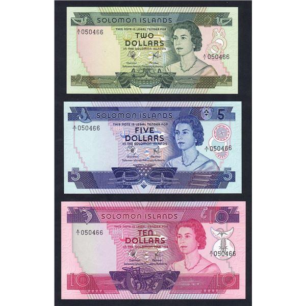 "SOLOMON ISLANDS 2, 5 & 10 Dollars. 1977. 1ST PREFIX MATCHED SERIAL SET ""A/1 050466"""