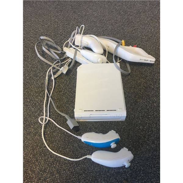 Wii system with Many Accessories INCLUDING ROCKBAND GUITAR - Works