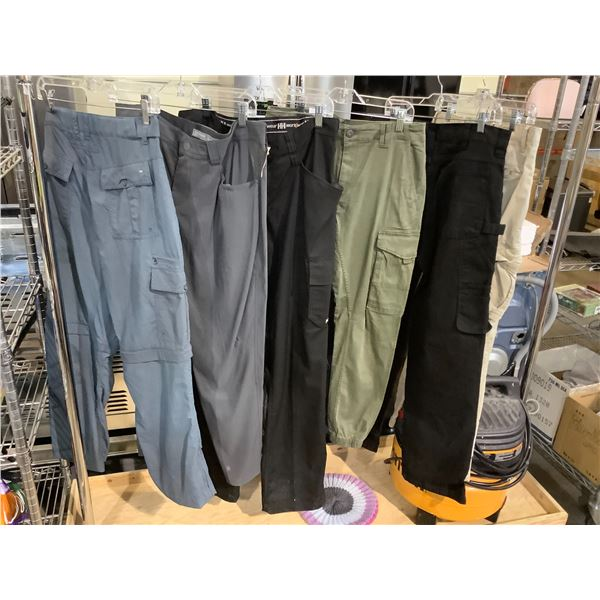 6 PAIRS OF SIZE 34 PANTS BRANDS INCLUDE: HELLY HANSEN (NEW WITH TAGS), ICE BREAKER, MEC, & MORE