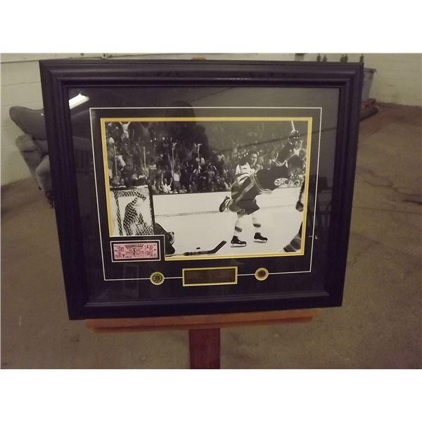 """Framed """"THE GOAL"""" Bobby Orr Famous photo with Boston Bruins game ticket stub. Boston Bruins token. N"""