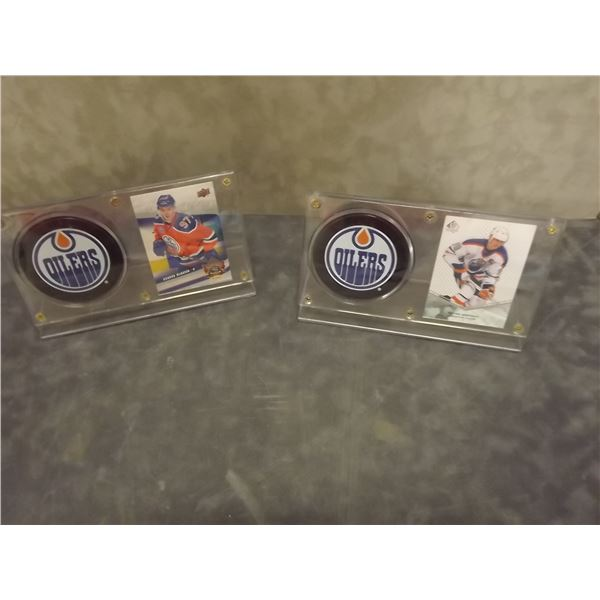 2 Hockey Cards and pucks in cases M&D)