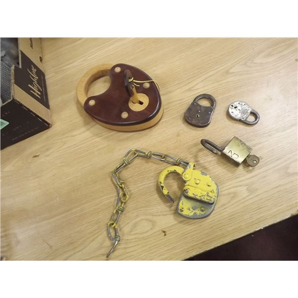 Lot of vinatge locks. CNR & other. 5 total. One is large handcrafted wooden (O)
