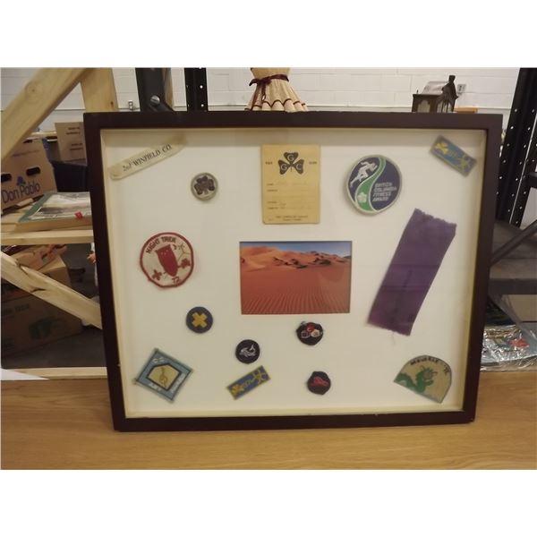 Framed picture of girl guide badges 1970's (O)