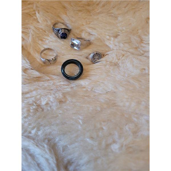 Set of 4 sterling silver rings. One Jade ring. Vintage