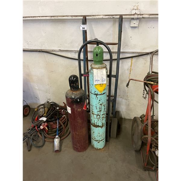 2 METAL HAND DOLLIES WITH 2 COMPRESSED GAS CYLINDERS