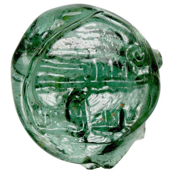 UMAYYAD/ABBASID: Anonymous, ca. 700-900, glass vessel stamp (3.10g). EF