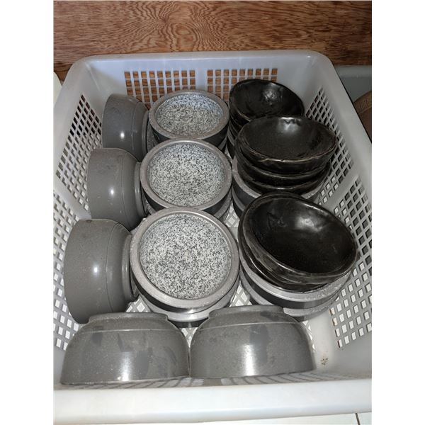 a bucket lot of soup bowls